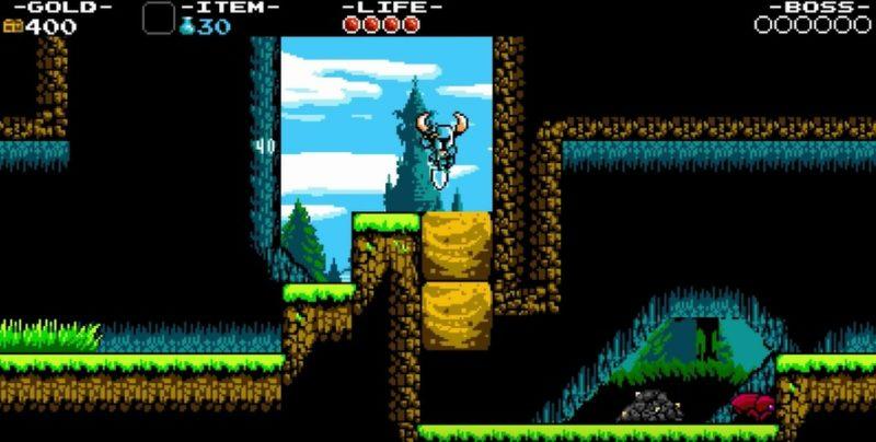 Shovel Knights spade riktas i en nedåtstöt och kan användas på flera sätt, på bilden ser vi hur han får ett par block att krossas alldeles strax.